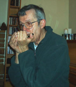 Walter A Cooke playing harmonica